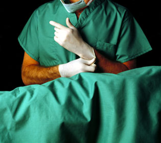 Plastic surgeon preparing for surgery